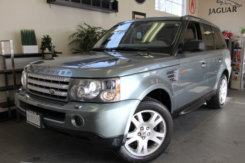 2006 Land Rover Range Rover Sport HSE 4dr SUV 4WD Automatic Green Tan This is a beautiful vehicl