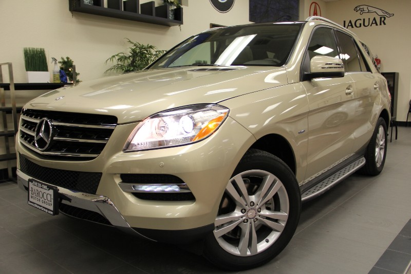 2012 MERCEDES M-Class ML350 4MATIC AWDNAVIGATION Automatic Gold Tan This Beautiful ML350 with