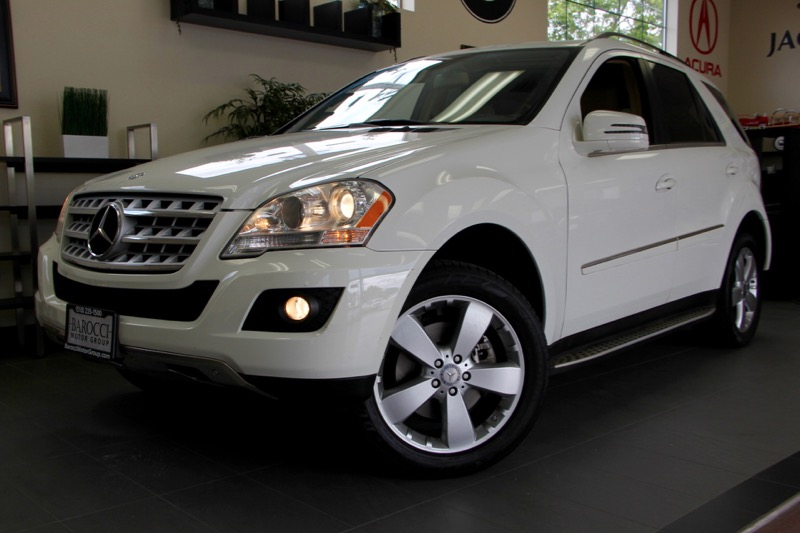 2011 MERCEDES M-Class ML350 4dr SUV 7 Speed Auto White Tan This is a beautiful SUV for the fami
