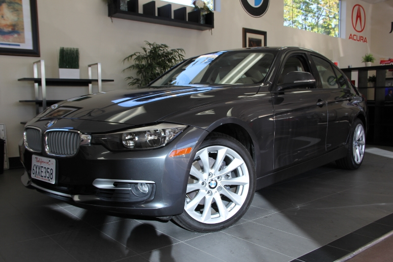 2012 BMW 3 Series 328i 4dr Sedan SULEV Automatic Gray Black This car is in like new condition a