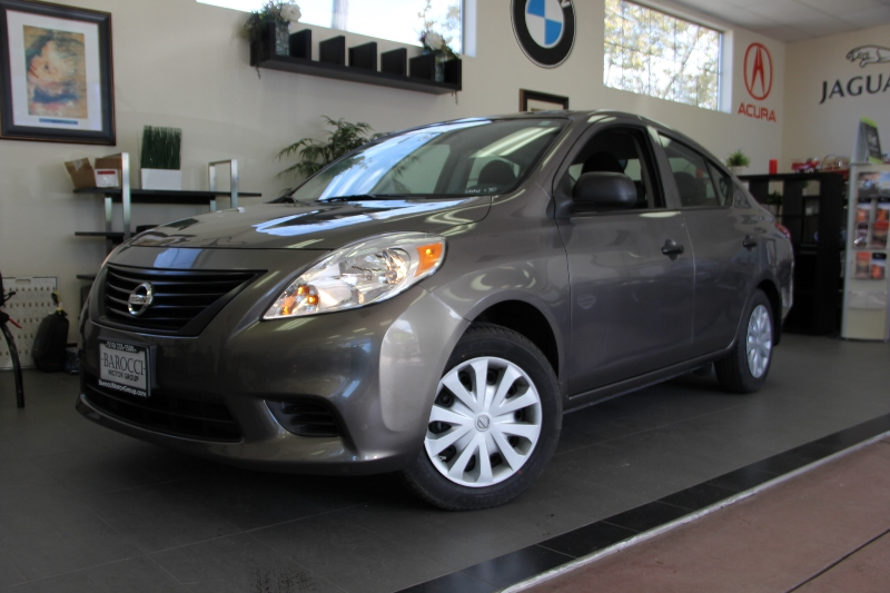 2014 Nissan Versa 16 S 4dr Sedan 5M 5 Speed Man Gold Child Safety Door Locks ABS Brakes Elec