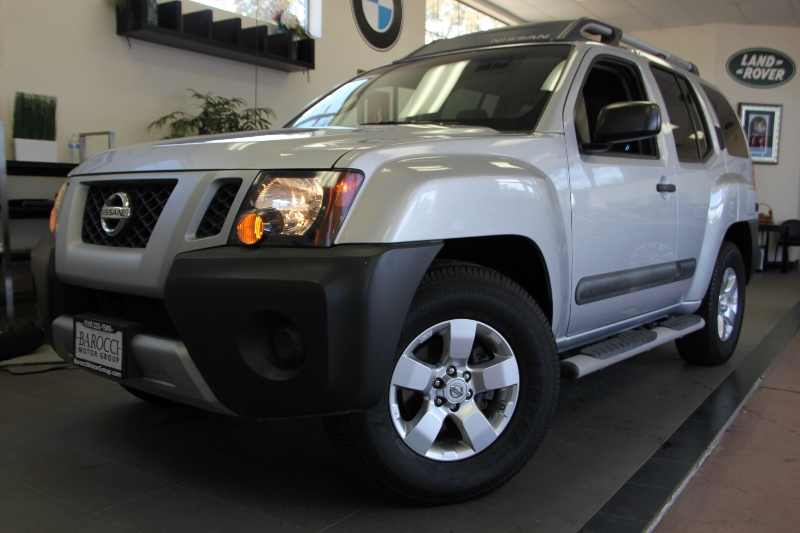 2011 Nissan Xterra X 4x2  4dr SUV 5 Speed Auto Gray Gray This is a beautiful vehicle in great c