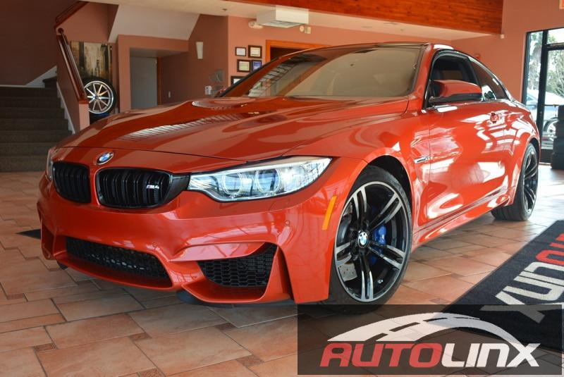 2015 BMW M4 Coupe 6-Speed Manual Orange Black One Owner and Still under factory warranty Execu