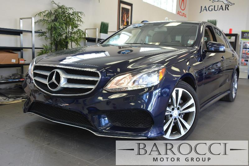 2014 MERCEDES E-Class E350 Sport 4dr Sedan Automatic Blue Tan Comes with the Premium Harman Kar