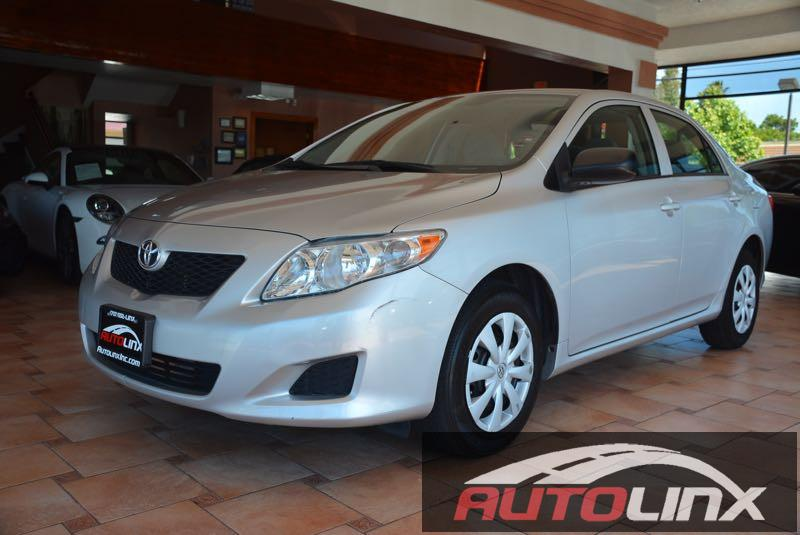 2010 Toyota Corolla Base 4-Speed AT 4-Speed Automatic Silver Gray Hold on to your seats Its ti