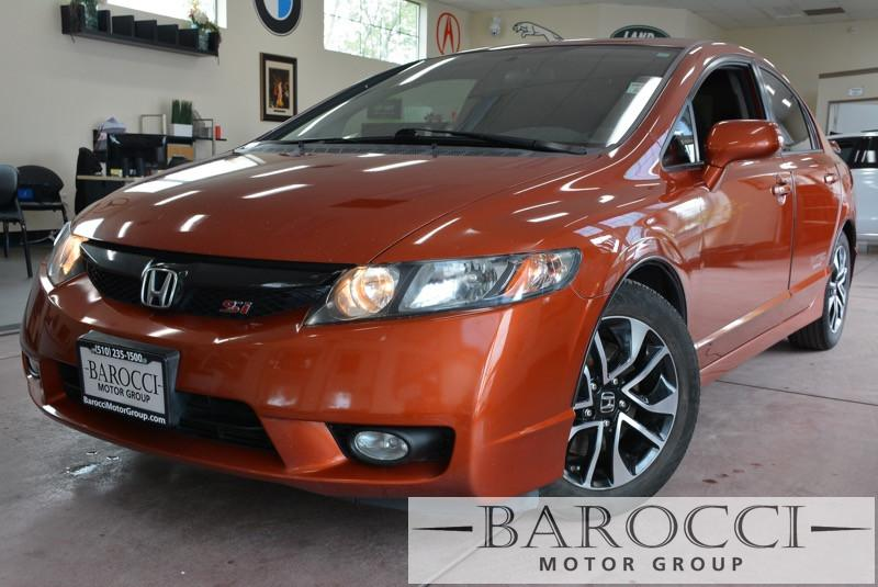 2010 Honda Civic Si 4dr Sedan 6 Speed Man Orange Black This is a striking 2010 Honda Civic Or