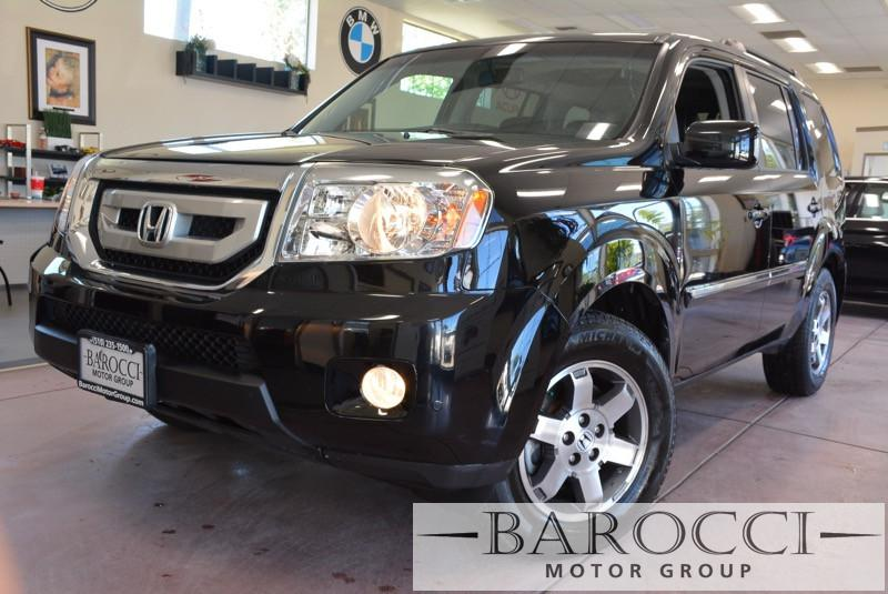 2010 Honda Pilot Touring 2WD 5-Spd AT 5-Speed Automatic Black Black This is a sublime one owner