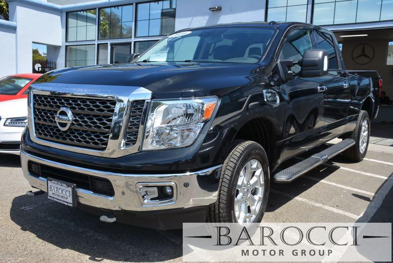 2016 Nissan Titan XD SV 4x4  4dr Crew Cab Pickup 6 Speed Auto Black Black This is a super nice