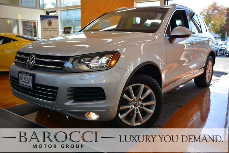 2014 Volkswagen Touareg V6 Sport AWD  4dr SUV 8 Speed Auto Silver Black We are proud to offer a